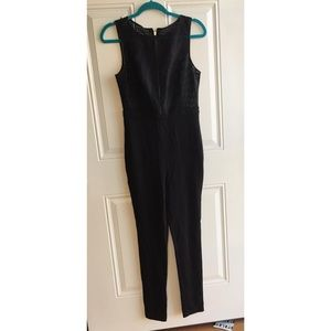 Black one piece jump suit with see through top
